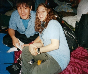 Miki and Mark try to catch some Zzzzzzzz's, but it is next to impossible here. (Photo by Terry Byrne Copyright 2004)