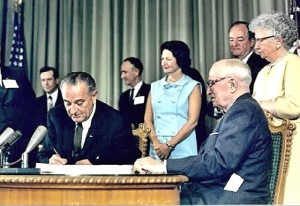 LBJ signs the Medicare law in 1965.