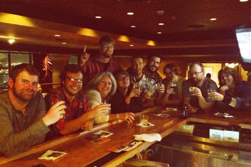 Birders perched on the bar. That's Matt, between my daughter and, far right. (Photo by bartender)