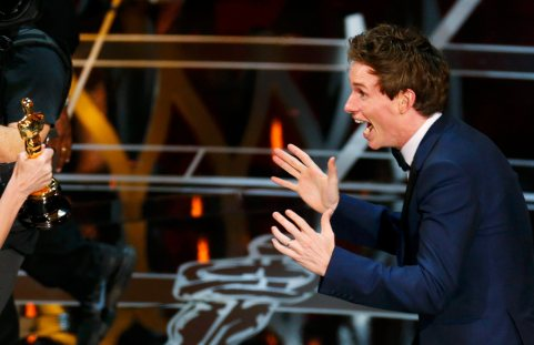"""Actor Eddie Redmayne reacts as he takes the stage to accept the Oscar for best actor for his role in """"The Theory of Everything"""" during the 87th Academy Awards in Hollywood, California February 22, 2015. REUTERS/Mike Blake (UNITED STATES TAGS:ENTERTAINMENT) (OSCARS-SHOW)"""